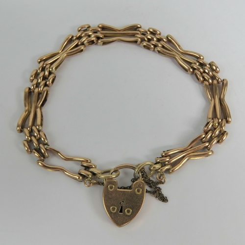 121 - A vintage 9ct rose gold bracelet having heart padlock clasp stamped 9c, one panel a/f, 12.3g....
