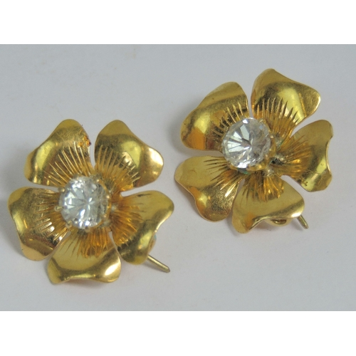 136 - A rare and unusual pair of diamond floral collar or lapel brooches, each having five petals and cent...