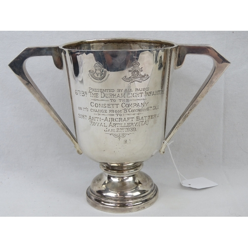 11 - A HM silver trophy cup having twin handles and engraved 'Presented by all ranks 6th Bn The Durham Li...