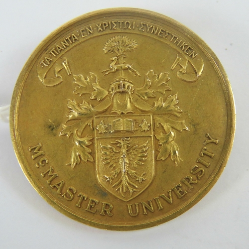 107 - A 10ct gold McMaster University Canada medal having crest and motto in Greek upon (All things cohere...