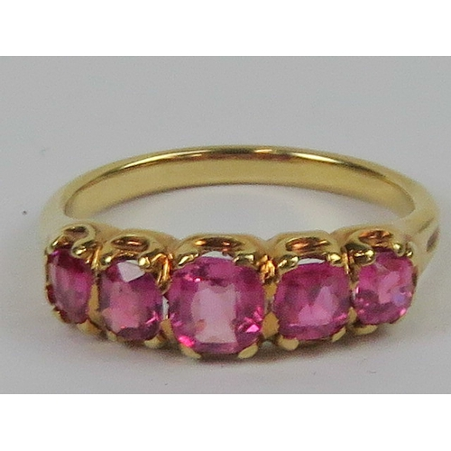 134 - A five stone pink sapphire ring (treated stones), the graduated stones weighing approx 1.4ct total, ...