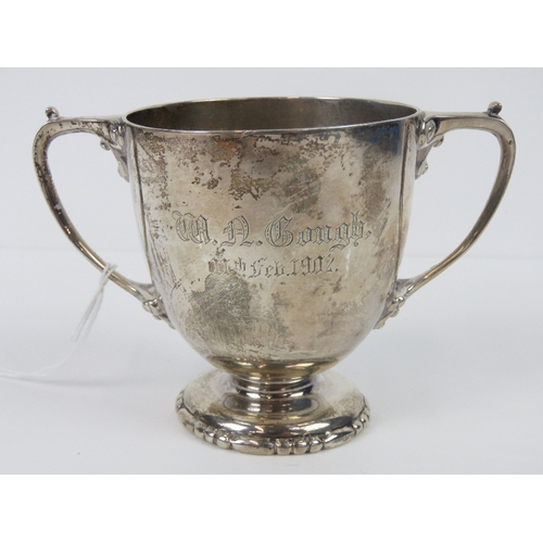 2 - A heavy HM silver twin handled trophy cup engraved 'W. A. Cough, 11th Feb 1902', hallmarked London 1...