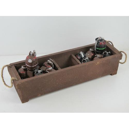16 - Twelve reproduction inert Mills grenades in transit tray, metal dummies with pins.