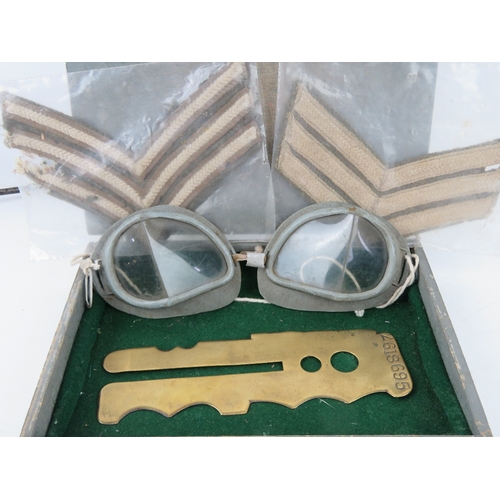 20 - An RAF Officer's small kit box containing cutlery, brass button polishing board, goggles, cloth badg...