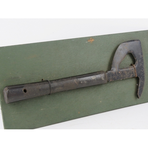 26 - A WWII RAF Lancaster Bomber escape hatchet, having broad arrow upon, marked Elwell and dated 1944. M...