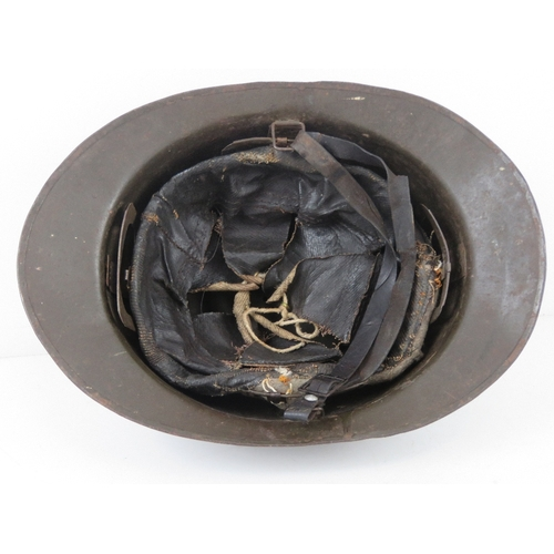 35 - A French 1939-1943 helmet having liner and chin strap, badges removed.