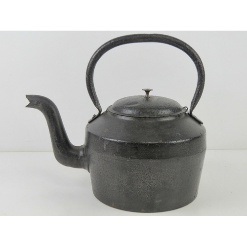 4 - A WWII British Military cast iron kettle having broad arrow upon and dated 1942. 32.5cm wide, 29cm h...