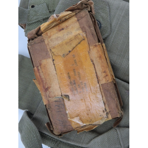 54 - Four US BAR magazines in canvas pouch, in unissued condition.