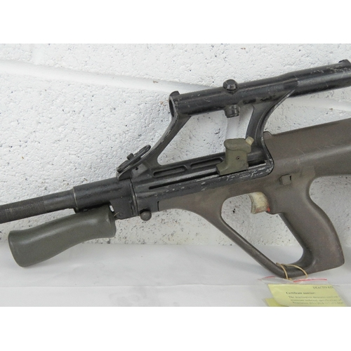 33 - A deactivated Steyr AUG 5.56mm assault rifle with optical sight, moving trigger, safety, cocking han...