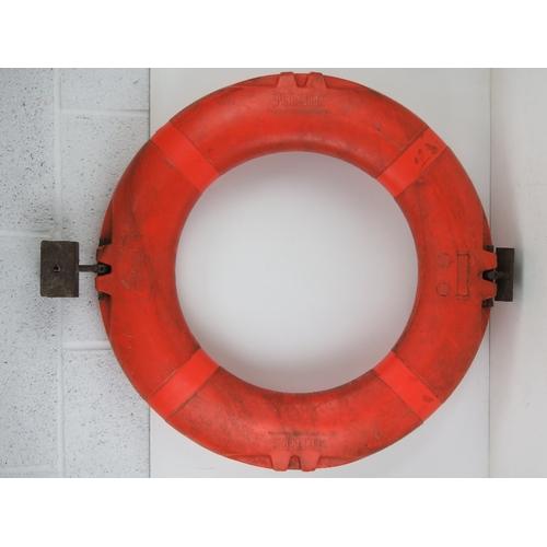 19 - A HMS Marlborough life preserver ring having mounting hooks attached.   Footnote: HMS Marlborough wa...