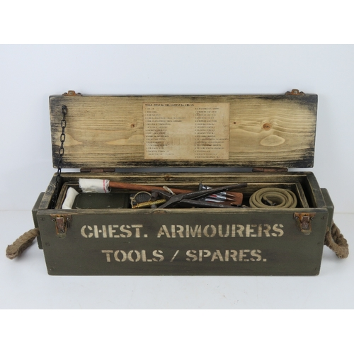39 - A box containing a British Enfield rifle armourer's kit and breach cover, inc; sling, clip of traini...