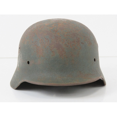 48 - A WWII German helmet, liner deficient.