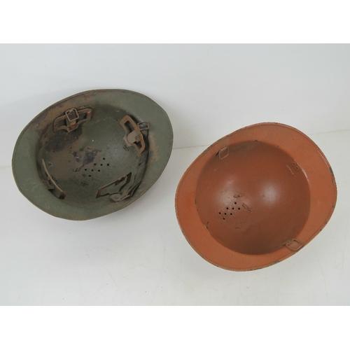 57 - Four WWI/WWII French helmets.