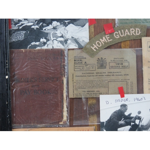 22 - A montage of assorted WWII items inc rations books, YHA handbook, German banknote, soldiers service ...