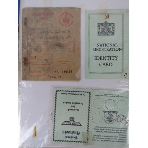 24 - A quantity of 20thC ephemera inc post war ration books, postcards, identity cards, souvenir books, M...