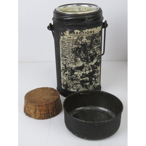 38 - Two military mess tins, an aluminium hot water, a canvas and felt covered water bottle and a black p...