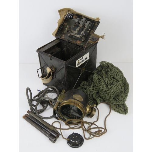 44 - A WWI signal lamp having metal and canvas covered case having clear glass lens with green and red pl...