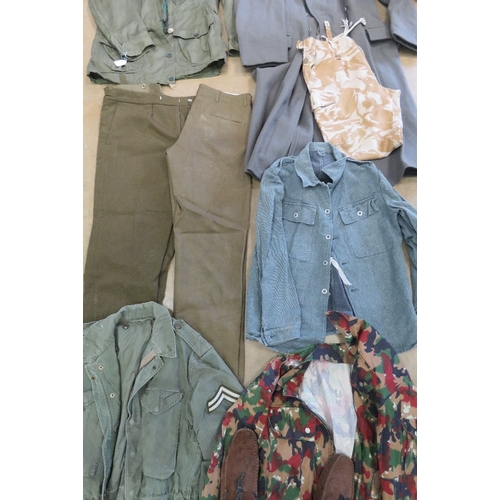 51 - A large quantity of assorted post war military uniform inc; British and German.