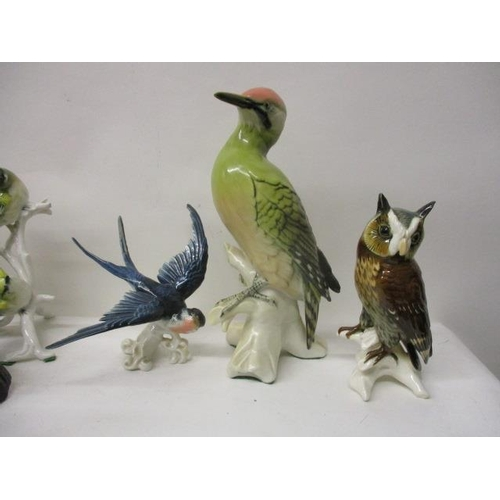 258 - Ten Karl Ens porcelain model ornaments to include eight birds and a rearing horse, 5 1/4