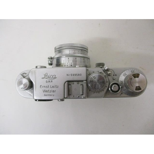 165 - A 1950s Leica IIIF camera Nr 599580 with a sennarr f-5cm 1:2 nR 902782 lens in a brown leather case...