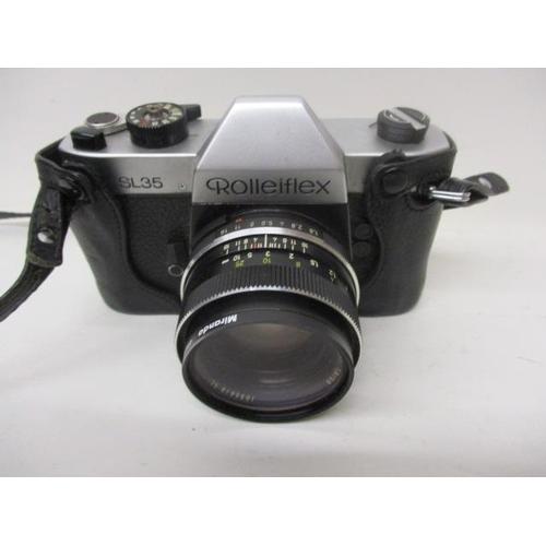 166 - A Rolleiflex SL35 camera with a Planar, 1.8/50 1055618 SL lens...
