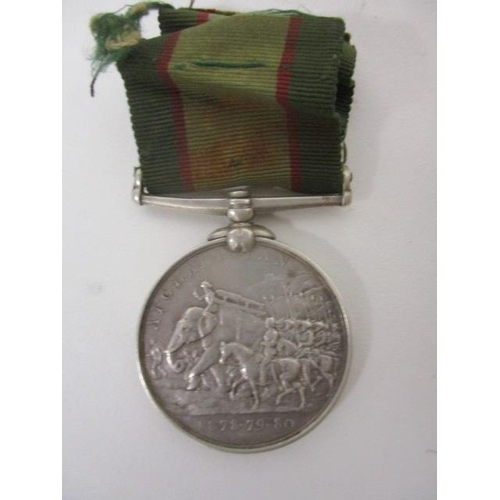 168 - A Victorian Afghanistan 1878-79-80 medal inscribed 1959 Sepoy Farzel 27th Punjab Infy with a green a...