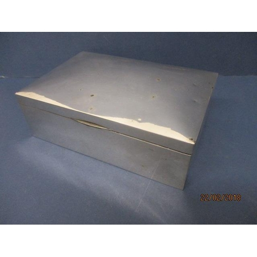 2 - An early 20th century silver cigar box by Charles S Green & Co Ltd, Birmingham 1916 with a hinged, d...
