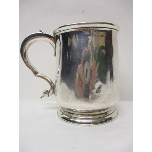3 - A George I silver tankard by Gabriel Sleath, London 1724, having a flared lip, tapered body and scro...