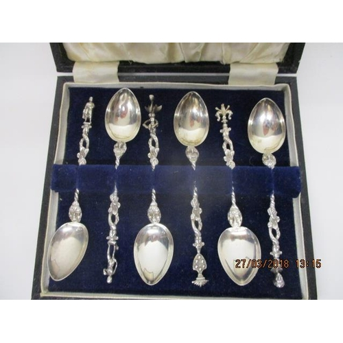 38 - A set of six silver coloured metal teaspoons with figural, bird, emblem finials, twisted and twig ef...