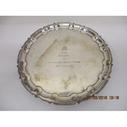 40 - An Edwardian silver salver having a scalloped edge by William Hutton & Sons Ltd, London 1909, with l...