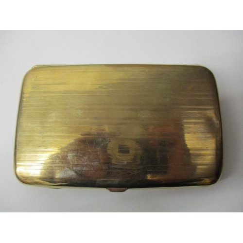 54 - A George V 9ct gold cigarette case of cushion form with stripped engine turned decoration, Birmingha...