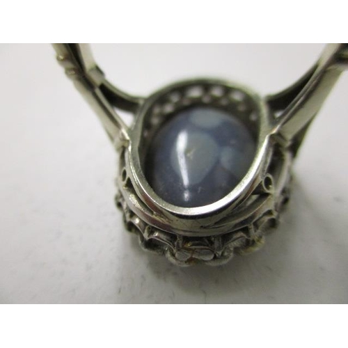 57 - An 18ct white gold ring set with twenty three diamonds around an opal doublet, opal approximately 17...