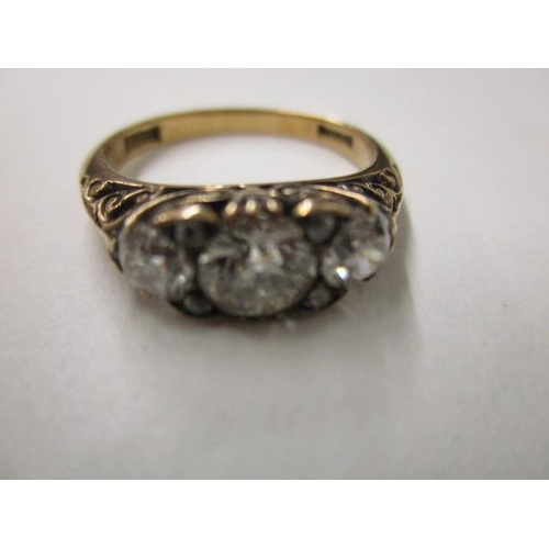 59 - An 18ct gold ring set with three diamonds approximately 1.4ct...