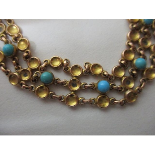 61 - A 10ct gold cup style link bracelet set with nine turquoise, 19g total...