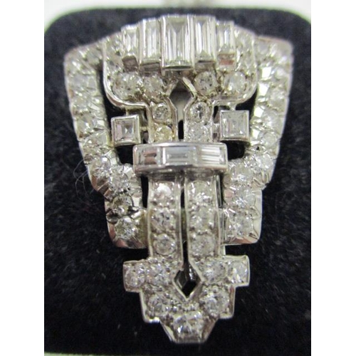 62 - A diamond set double clip duet brooch, each clip of openwork, geometric design, set throughout with ...