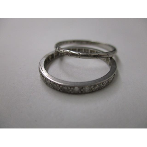 73 - A platinum wedding band and a white metal eternity ring set with diamonds, 3.8g...