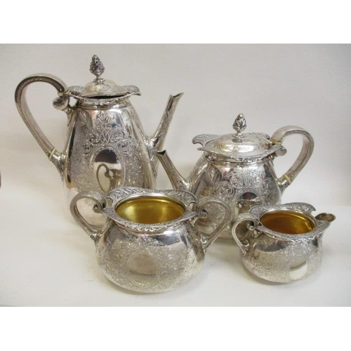 86 - A Victorian silver four piece teaset by Walter & John Barnard, London 1879 with ornate, pierced orna...