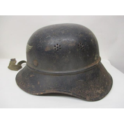 211 - A WWII German Luftsehutz Gladiator steel helmet with a decal to the front...