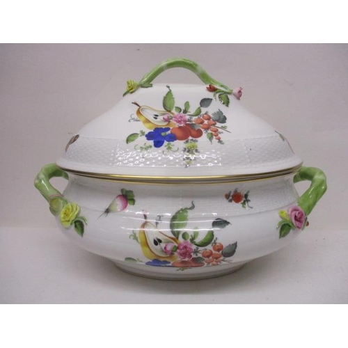 212 - A Herend porcelain tureen of oval form with a domed lid decorated with fruit, vegetables and nuts wi...