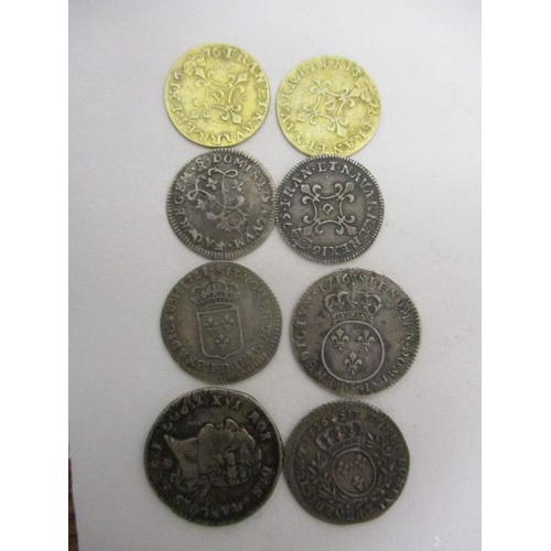 240 - Eight silver and silver gilt French coins to include examples struck with Louis XIV portrait, possib...