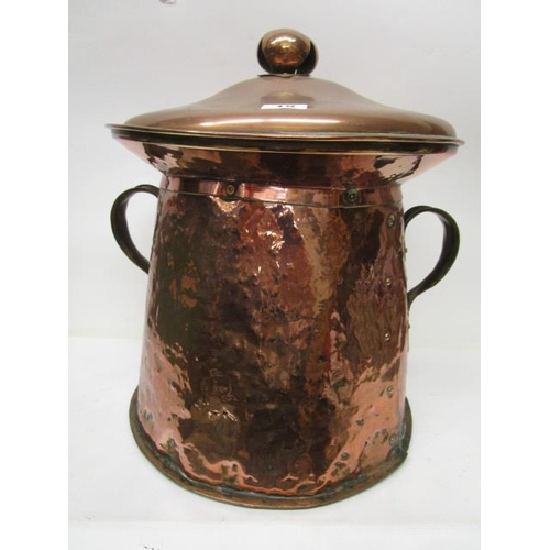 15 - An Arts & Crafts copper lidded container/coal bucket, twin handles with shaped terminals, stud-work ...