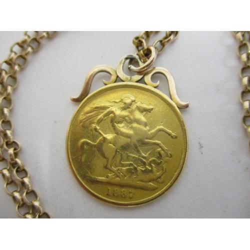 152 - A gold double sovereign 1887 on a yellow metal chain, 30g total...
