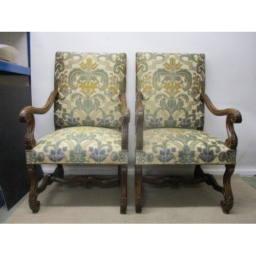 154 - A pair of late 19th century walnut framed armchairs, having a tapestry style fabric upholstered back...