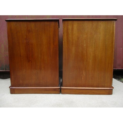 187 - A pair of Victorian mahogany pedestal chests with four graduated drawers and turned handles, on a pl...