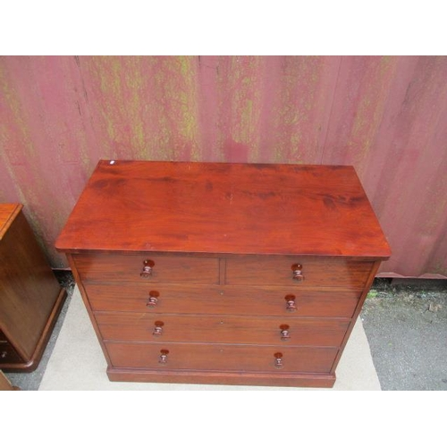 188 - A mid 19th century Holland & Sons mahogany chest of two short and three long drawers, with turned ha...