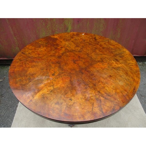 189 - A Victorian walnut and rosewood dining table having a veneered segmented top, over three barley twis...