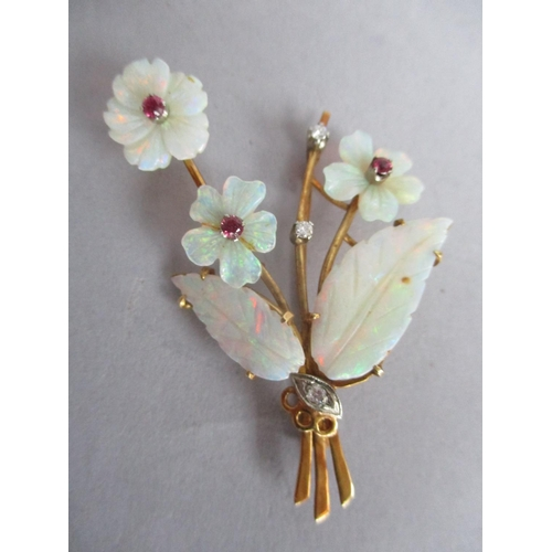 193 - A 1960s brooch fashioned as a bunch of flowers set with opals, rubies and diamonds, in an 18ct gold ...