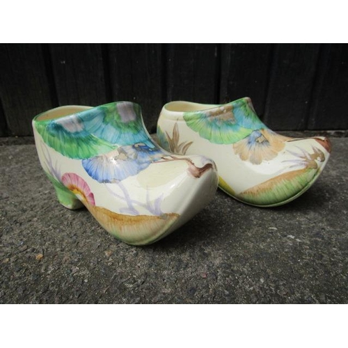 21 - A pair of Clarice Cliff Bizarre Rhodanthe pattern clogs decorated in green, blue, yellow, brown and ...