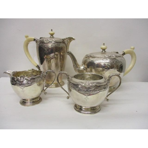 217 - A 1930s four piece silver teaset by Mappin & Webb, Birmingham 1939, each with cast and engraved deco...
