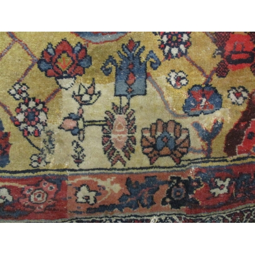 272 - A Persian carpet with Boteh, palmets, flowers and foliage on a mustard and black ground, 168